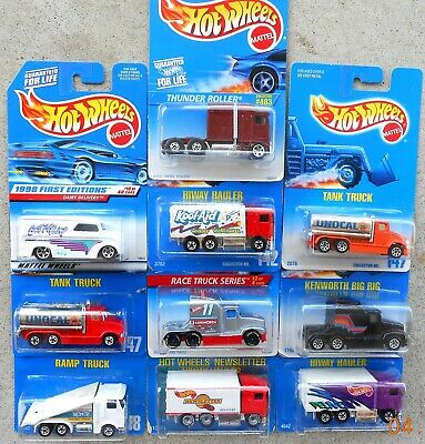 HOT WHEELS 10 TRUCKS.  KENWORTH SEMIS, TANKERS, AND MORE.    4 PICTURES