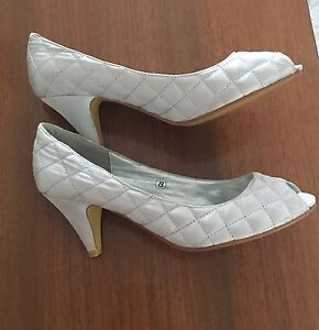 Size 8 Brand new silver shoes
