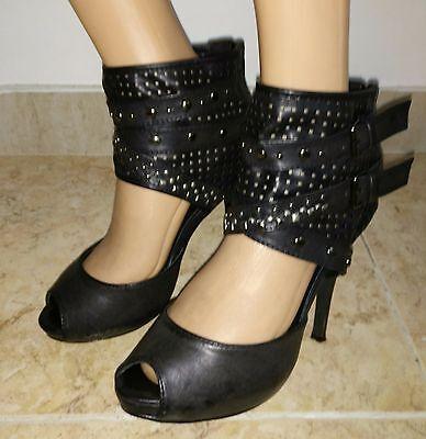 Zapatos abotinados de tacón