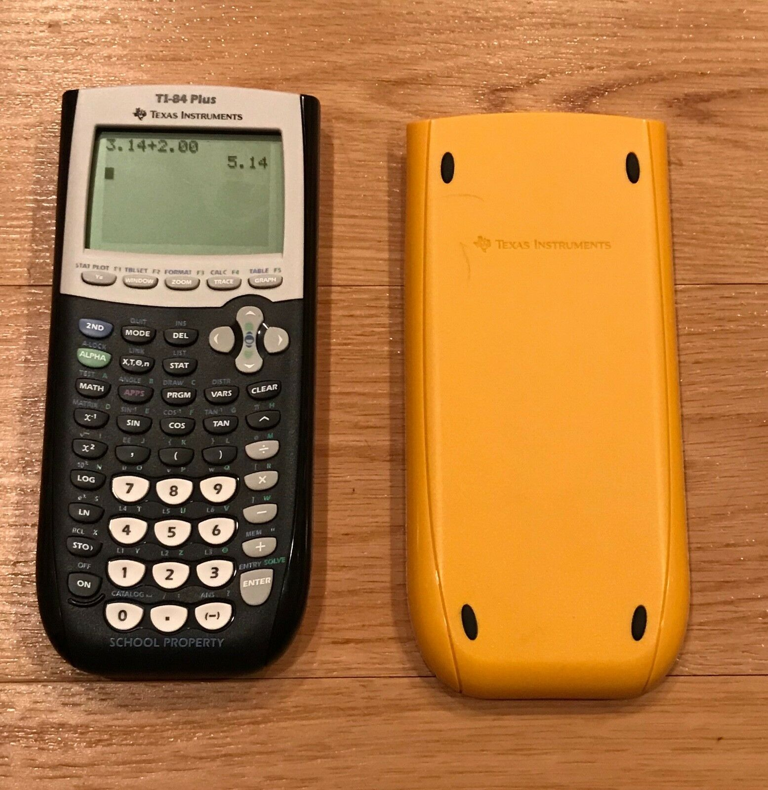 Texas Instruments TI-84 Plus Graphing Calculator School Property Edition Yellow