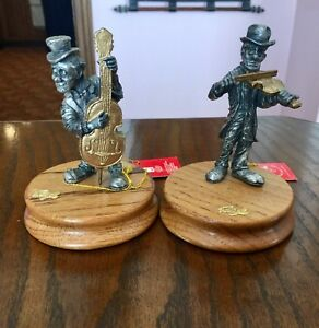 """Here's a pair of vintage """"Ron Lee Hobo Band"""" figurines"""