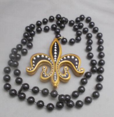 Mardi Gras Beads Black And Gold Fleur de Lis New Orleans March 5, 2019](Black And Gold Mardi Gras Beads)