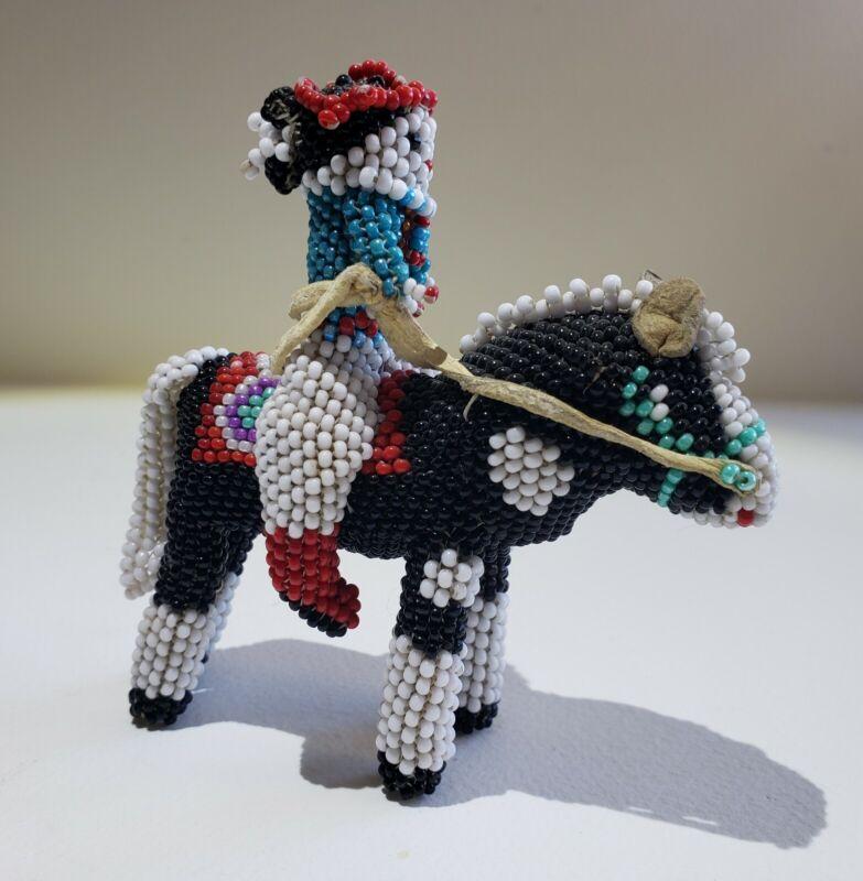 ZUNI NATIVE AMERICAN BEADED WOMAN ON HORSE