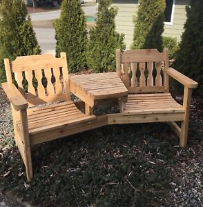 Cedar two-seat bench with table.
