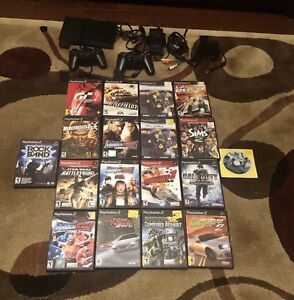 Sony Playstation 2 slim with games and extras