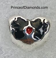 Silver coloured Mickey and Minnie Mouse believe in magic bead
