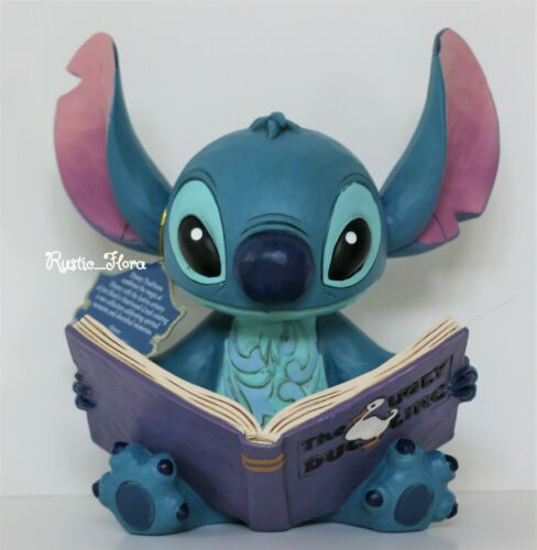Jim Shore Disney Traditions Stitch with Storybook, Finding a Family Figurine