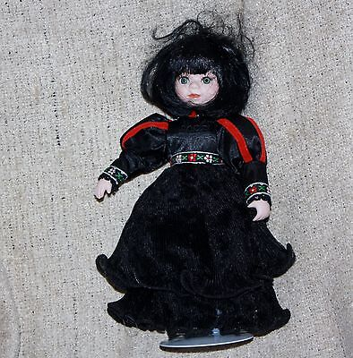 beautiful goth look porcelain doll signed & numbered on stand