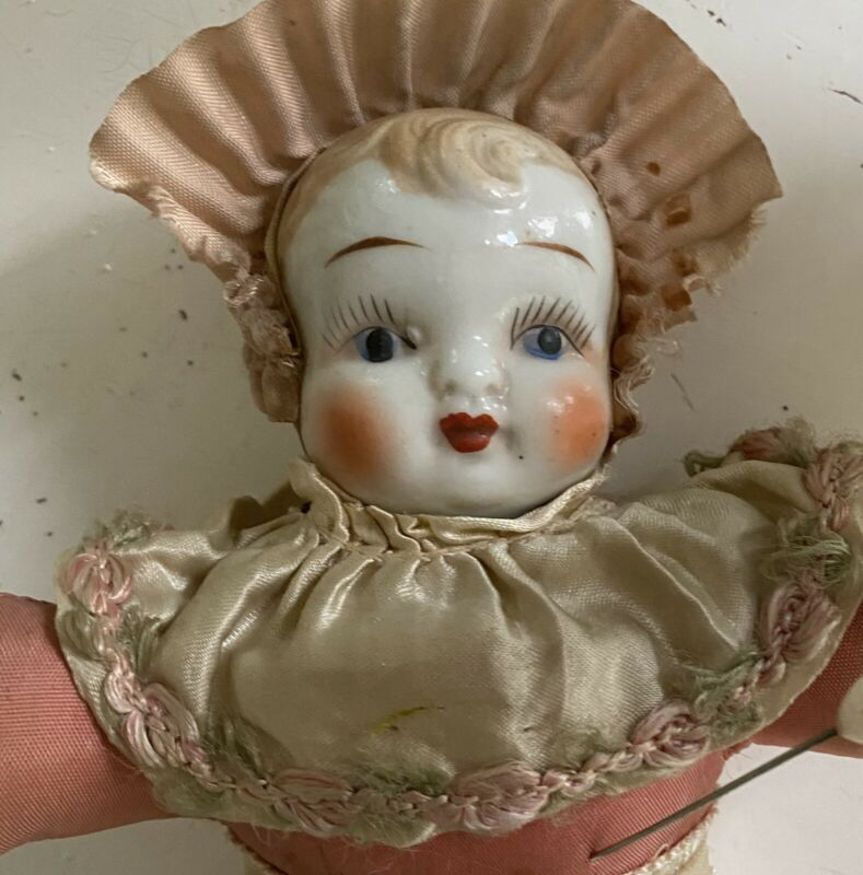 Antique Pink Silk Pin Cushion Doll Porcelain Face Ribbon Roses Fringe Skirt 1900