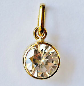 GOLD PENDANT SET WITH 7MM CUBIC ZIRCONIA. GENUINE 9CT, STAMPED 375