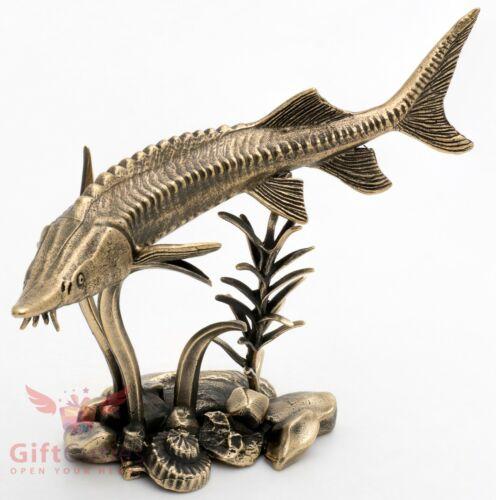 Bronze Figurine of sturgeon fish swimming through underwater flora