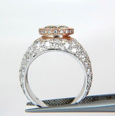 GIA Certified 3.08ct. Fancy light brown round cut diamond ring 14kt + 6