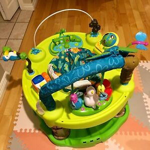 Exersaucer toy with batteries includes