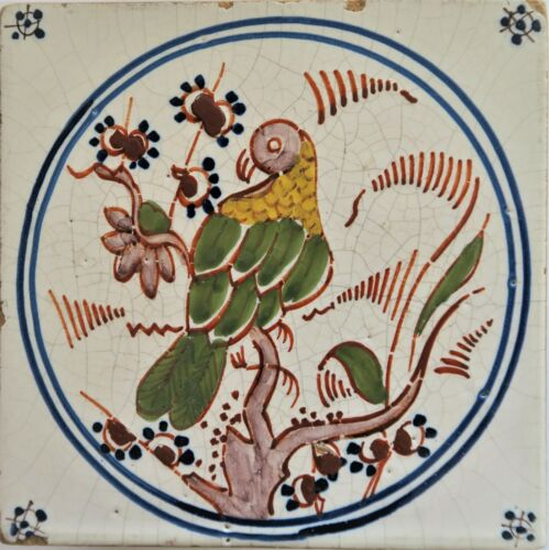 An interesting FRENCH FAIENCE tin glazed tile carreau with a polychrome parrot.