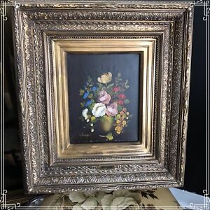 Floral bouquet antique oil painting