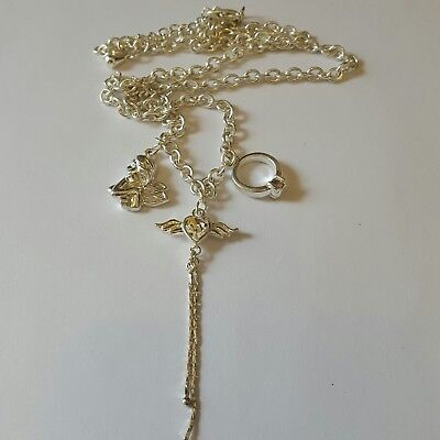 A beautiful silver tone necklace with charms