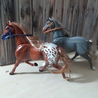 Set of 2 Toy Horses push heads down for neighing trotting Sounds with harness.