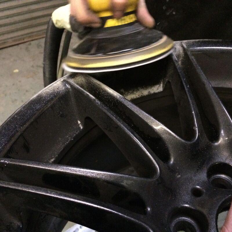 Preparing the wheel with a DA (Dual Action) Sander.