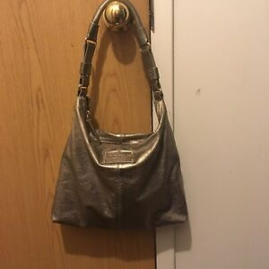 Pewter/gold leather purse Kate spade