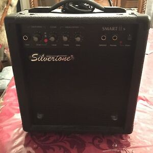 Silver tone guitar and Amp $250. Hardly played.