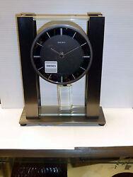 SEIKO  BLACK METAL AND GLASS OPEN PENDULUM CONTEMPORARY CLOCK QHN004KLH