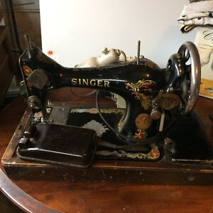 Antique Singer iron sewing machine with wooden cover