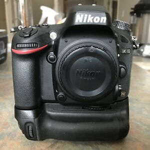 Nikon D610 with OEM grip and extra battery
