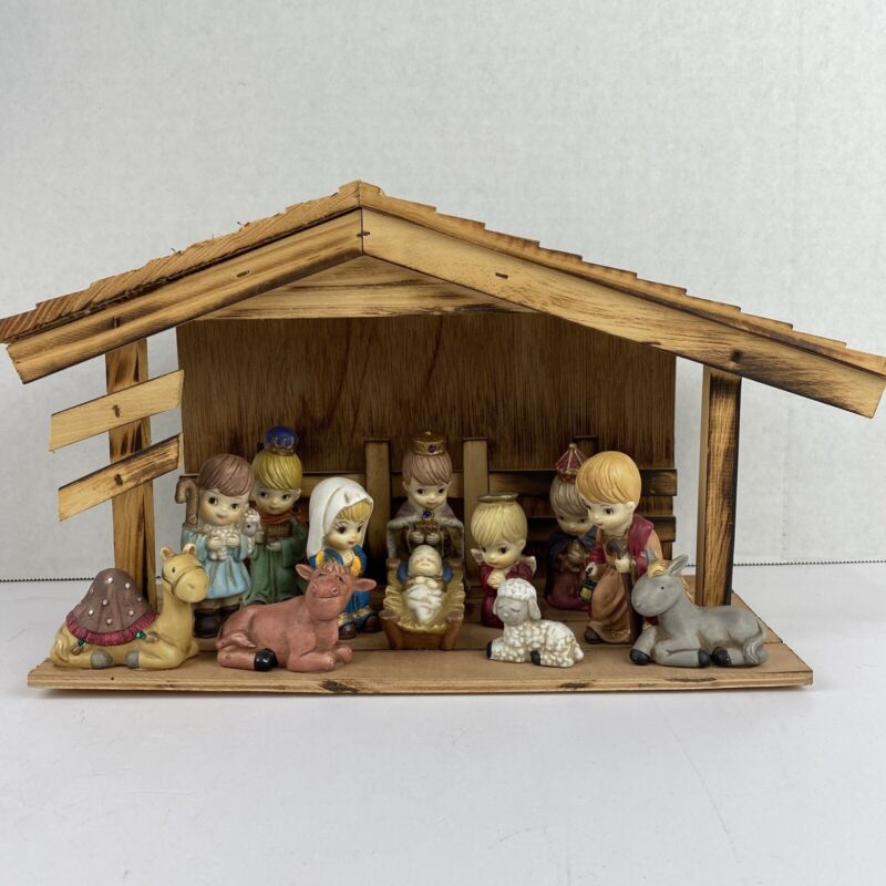 12 Piece Porcelain Nativity With Wooden Manger Set. Absolutely Gorgeous.