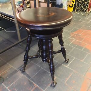 Antique Piano Stool with Ball and Claw feet.