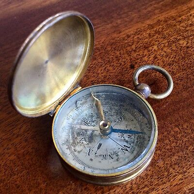 A 19th Century Lacquered Brass Pocket Compass, With Brushed Steel Dial.