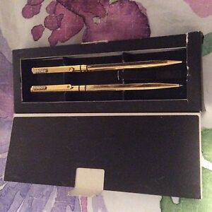 gold coloured pen and pencil set