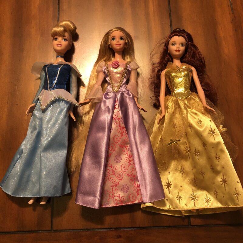 lot of 3 disney barbie princess bella sinderella and rapunzel Dolls
