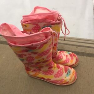 Girl sneakers and rain boot