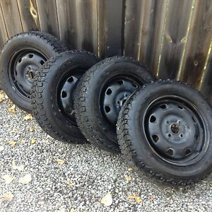 Winter tires and rims  185/60R14  $450