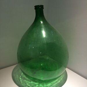Large green glass jug