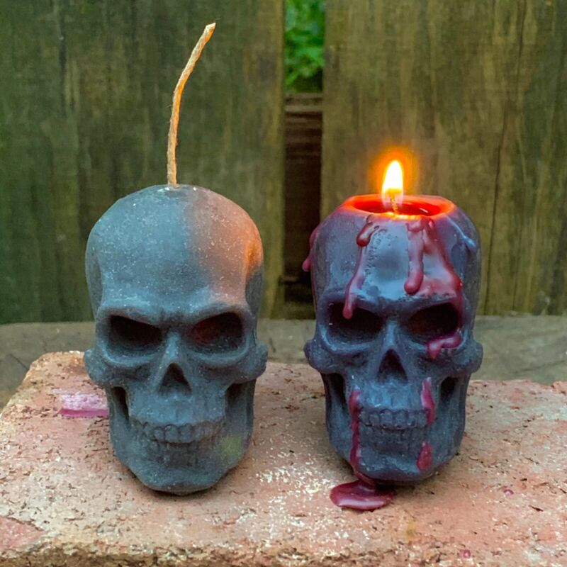 Boo! Halloween BLEEDING Skull  Black Beeswax Candle. Bleeds red wax when burnt!