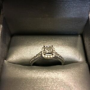 One lady's 14 karat white gold engagement ring $1500 obo