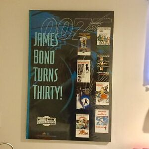 James Bond 007 posters mounted on white board
