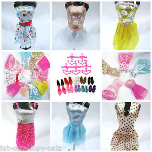 LOT-OF-12-15-or-20-BARBIE-SINDY-DOLL-ITEMS-DRESSES-SHOES-BOOTS-HANGER-COMB-TIARA