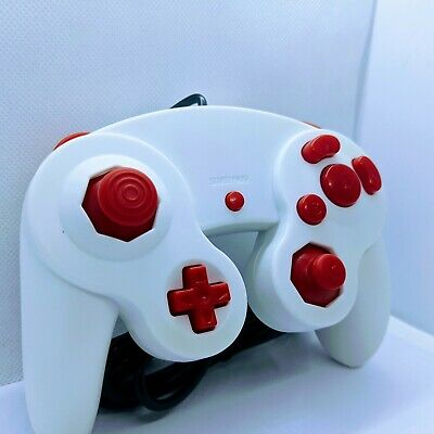 White Gamecube Controlle with Red Buttons