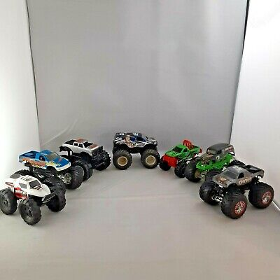Lot of 7 Hot Wheels Monster Jam 1:64 Toy Trucks Grave Digger, Cowboy, T-Maxx