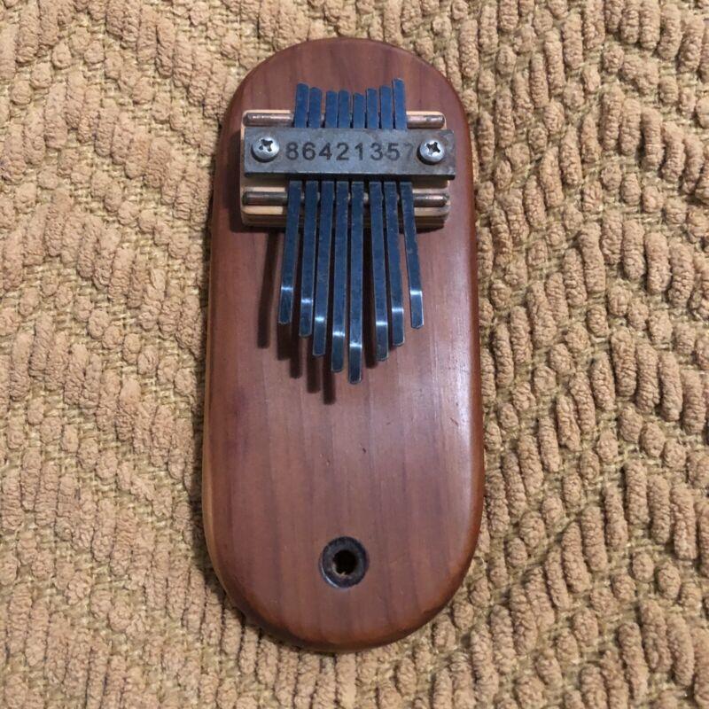 Small Kalimba/Mbira. Beautiful, with numbered keys!