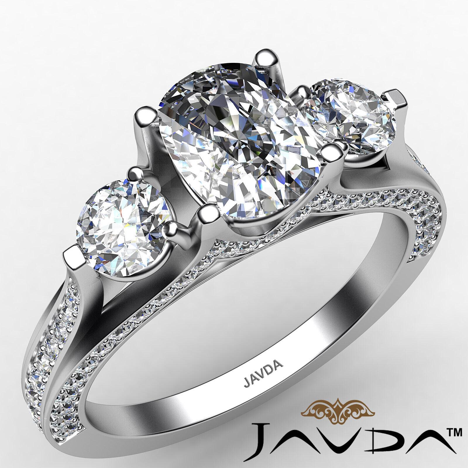 Three Stone Cushion Diamond Engagement Ring GIA, J Color & VS2 clarity 2.2 ctw.