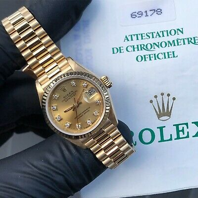 Ladies 18ct Gold Rolex Oyster Perpetual Datejust with Factory Champagne Dial.
