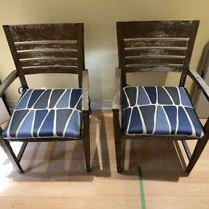 Teak chairs, pair come with blue patio cushions and teak oil