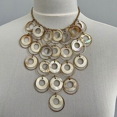 60s -70s Jewelry – Necklaces, Earrings, Rings, Bracelets Statement Necklace 1950s 1960s Retro Mod Round Metal White SHELL Discs Bib $20.73 AT vintagedancer.com