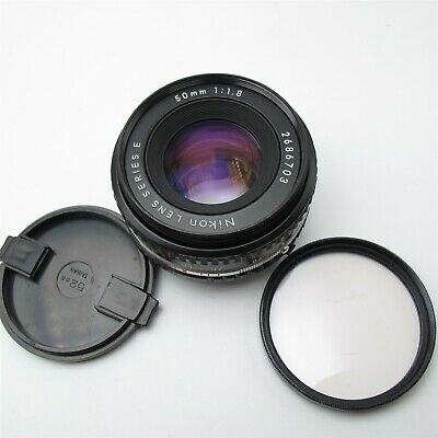 Nikon 50mm F/1.8 Manual focus lens AiS mount W/ Filter and front Cap Nice