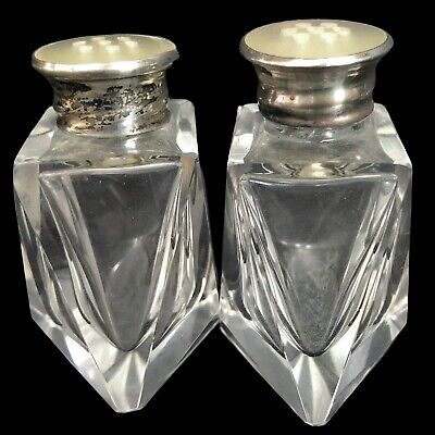 2 mother of pearl and silver top salt and pepper pots with glass bases