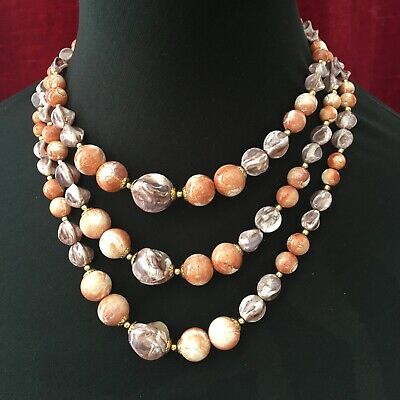 60s -70s Jewelry – Necklaces, Earrings, Rings, Bracelets Vintage 1960's Triple Strand Plastic Bead Necklace Beaded Clasp $8.20 AT vintagedancer.com