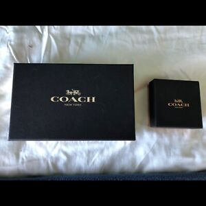 Coach brand name earrings and wristlet: Never been opened